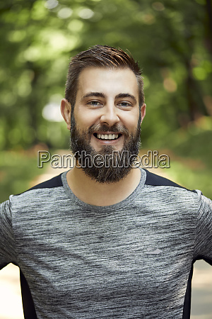 portrait of smiling sporty man in
