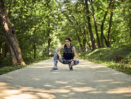 portrait of sporty young woman crouching