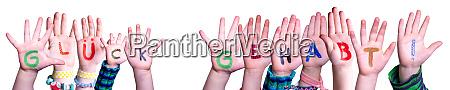 children hands building word glueck gehabt