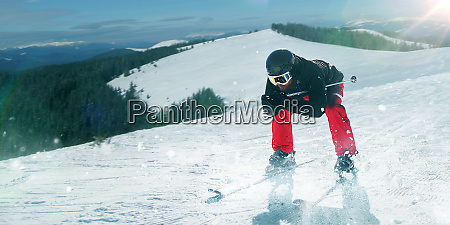 skier in helmet and glasses riding