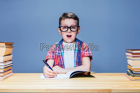 schoolboy learns homework education concept