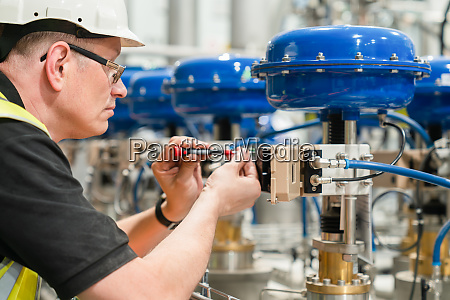 engineer checks an pneumatic valve with