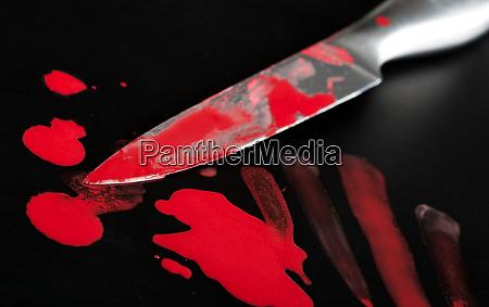 knife in blood