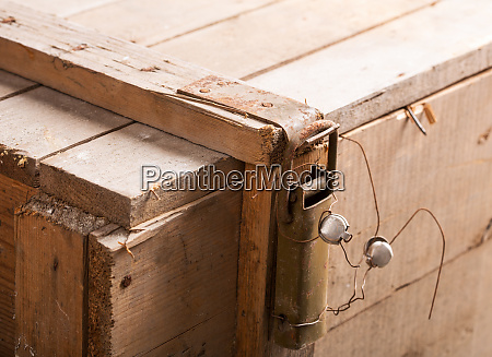 latch with seal on wooden chest