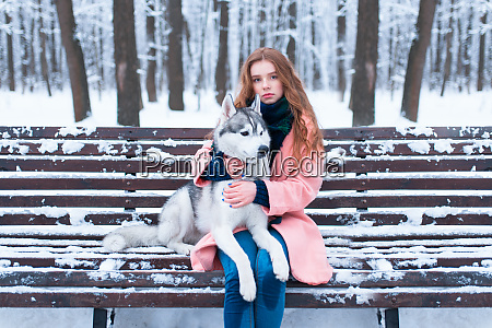 woman sitting on the bench with