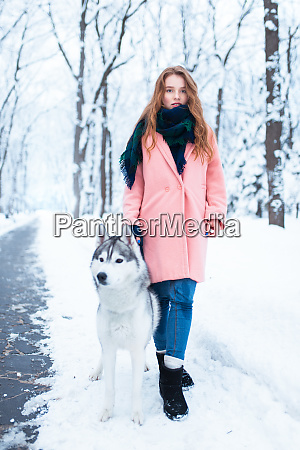 portrait of young woman with husky