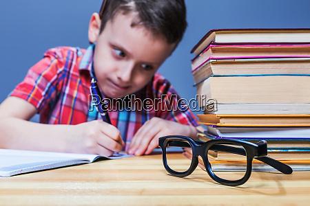 schoolboy study at school homework learning