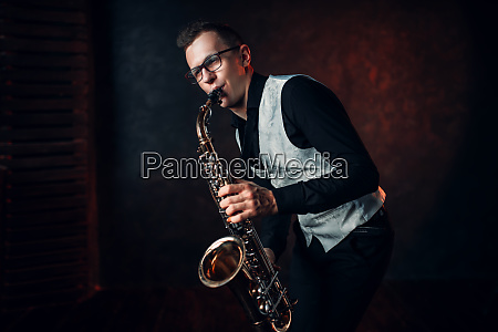 male saxophonist playing classical jazz on