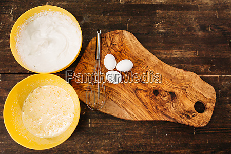 eggs on wooden board bowls with