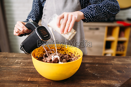 female hands mixing cake ingredients