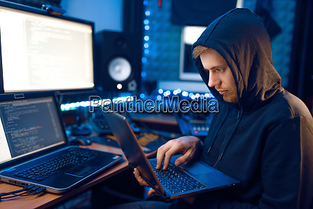 hacker in hood shows thumbs up