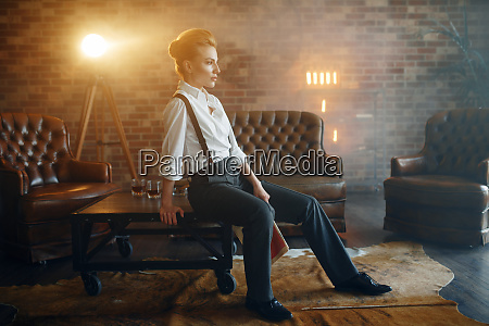 woman in shirt and trousers retro