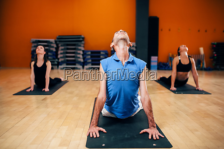 stretching exercise female yoga group with