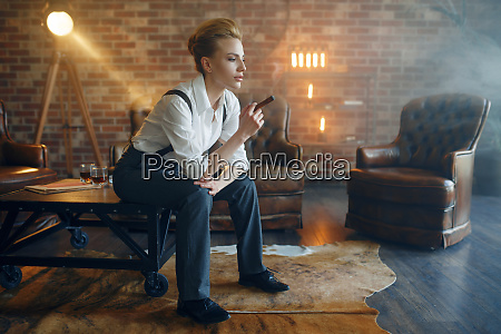 woman in strict clothes sitting on