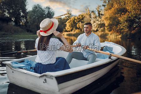 love couple boating on lake at