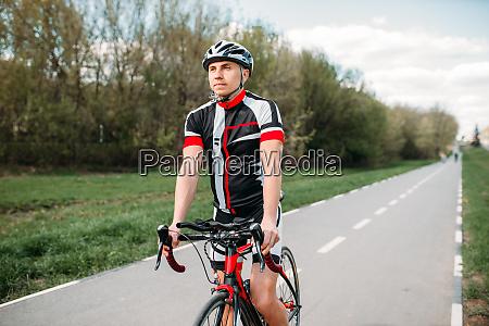 cyclist in helmet and sportswear on