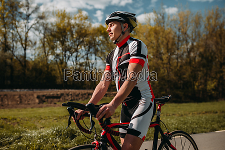 male bicyclist in helmet and sportswear