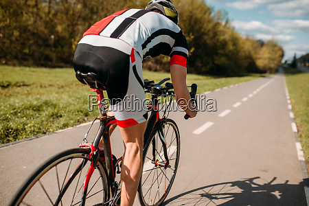cyclist in helmet and sportswear rides