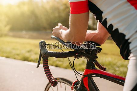 male bycyclist in sportswear cycling on
