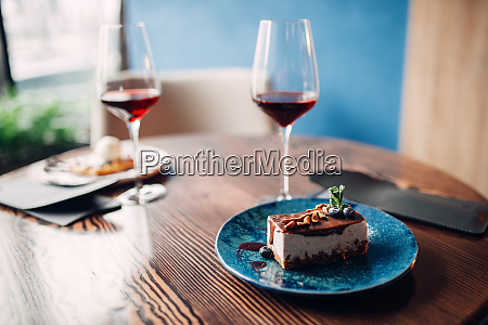 dessert on plate and red wine