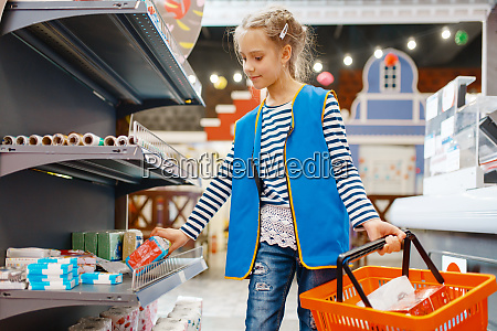 cute girl with basket playing saleswoman