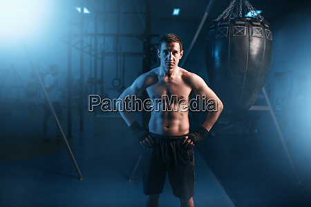 portrait of athletic boxer in black