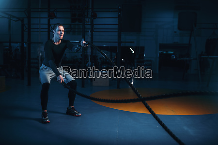 sportsman on training workout with battle