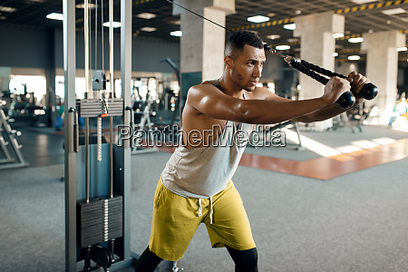 athlete, at, exercise, machine, in, motion, - 28061591