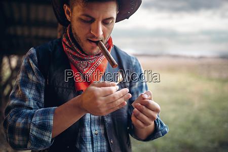 bearded, cowboy, lights, a, cigar, , wild - 28061840
