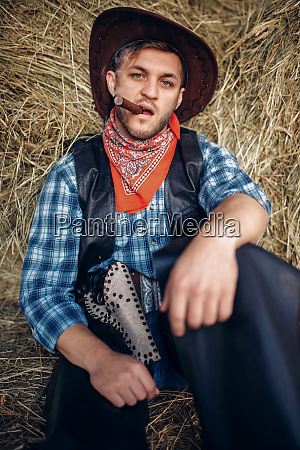 brutal, cowboy, poses, with, cigar, and - 28061920
