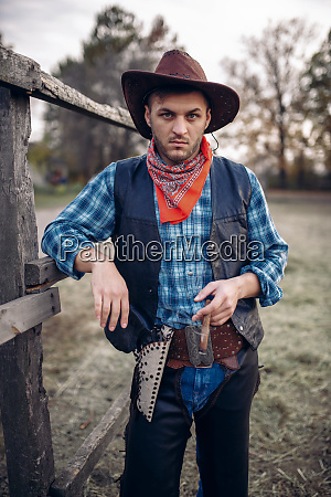 brutal, cowboy, with, cigar, in, the - 28061966