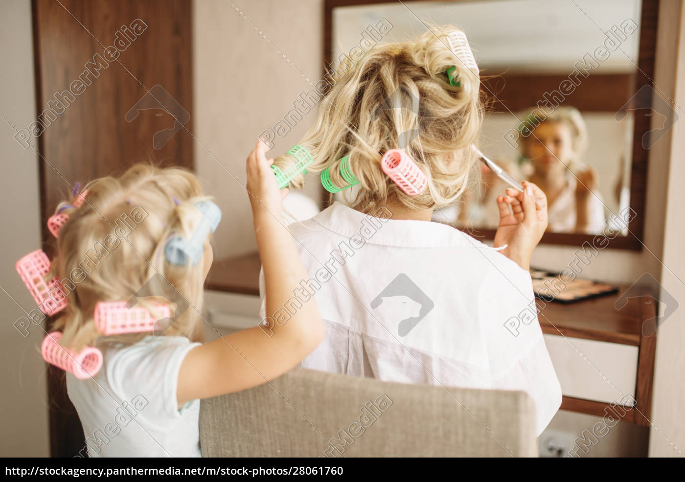child, makes, a, funny, hairstyle, to - 28061760