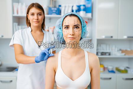 cosmetician, holds, botox, syringe, and, female - 28061957