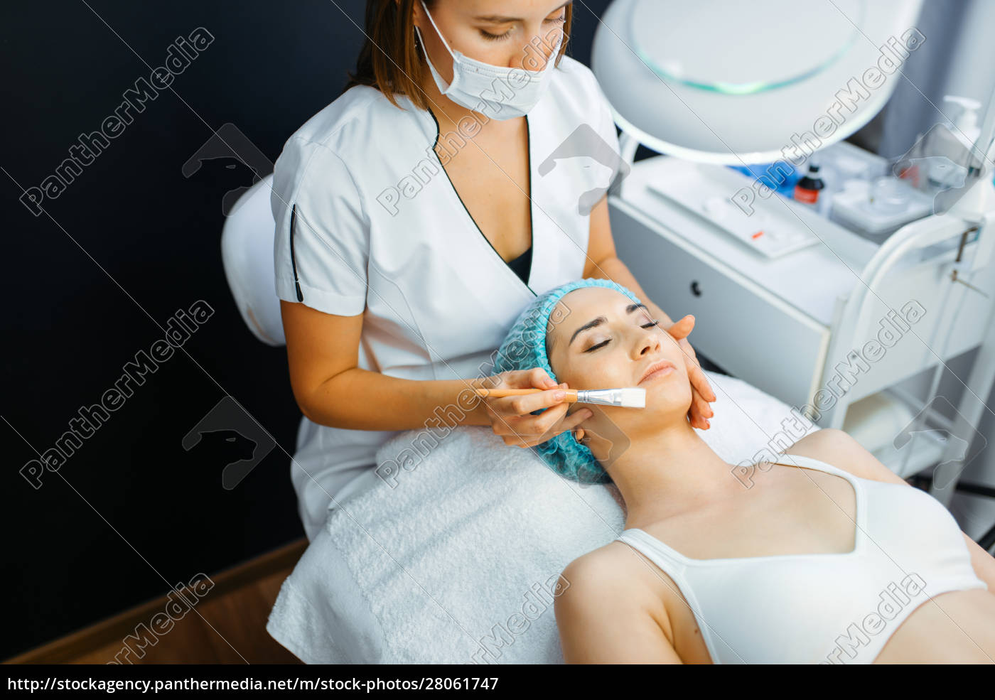 cosmetician, with, brush, cleans, facial, skin - 28061747