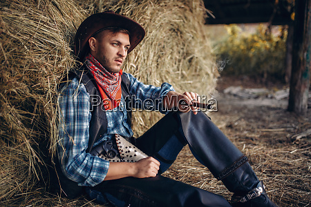 cowboy, relax, with, cigar, , haystack, on - 28061945