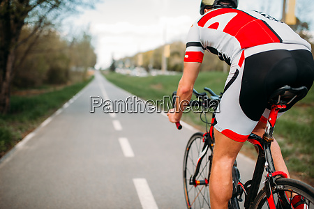 cyclist, in, helmet, and, sportswear, rides - 28061698