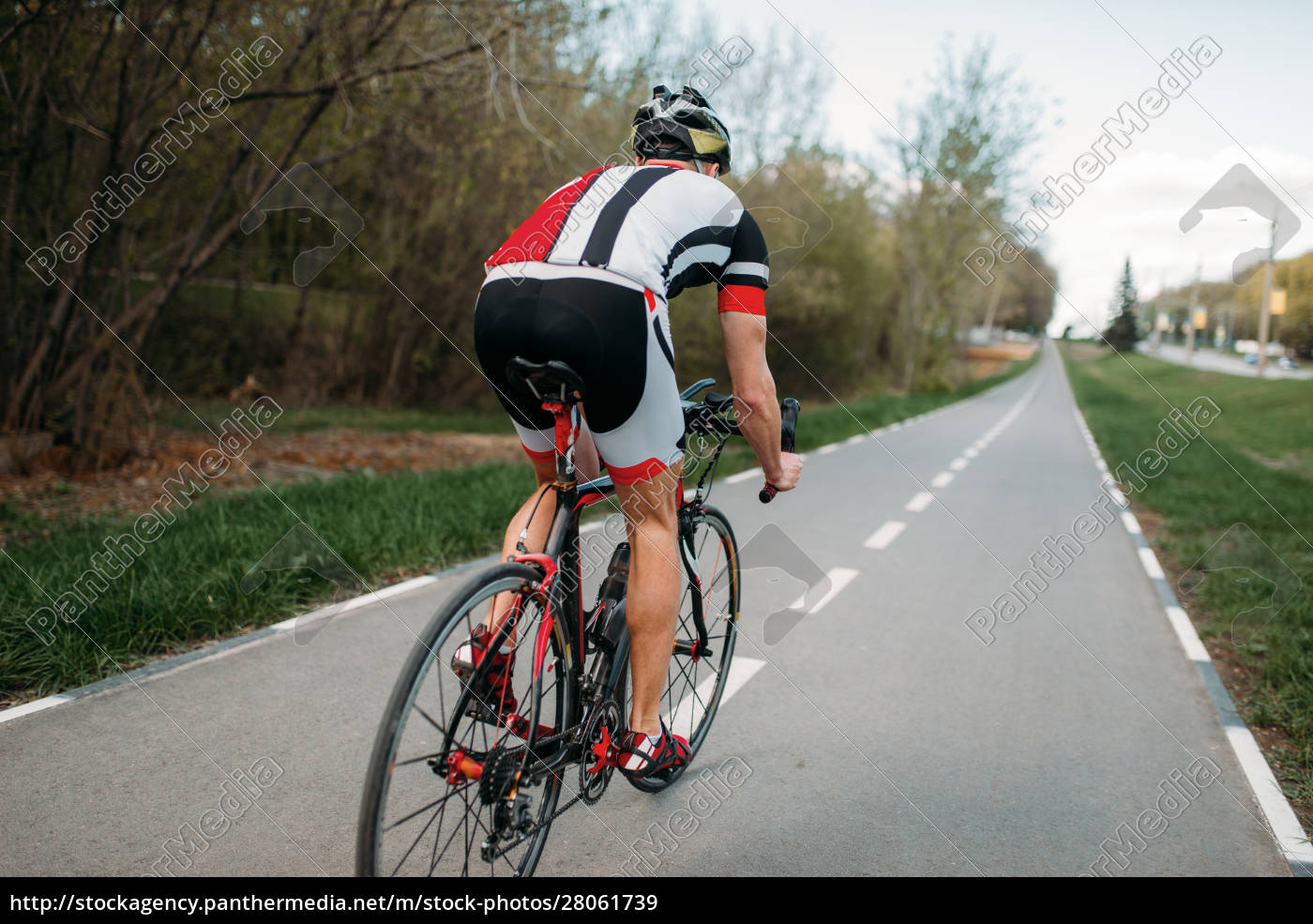 cyclist, in, helmet, and, sportswear, rides - 28061739