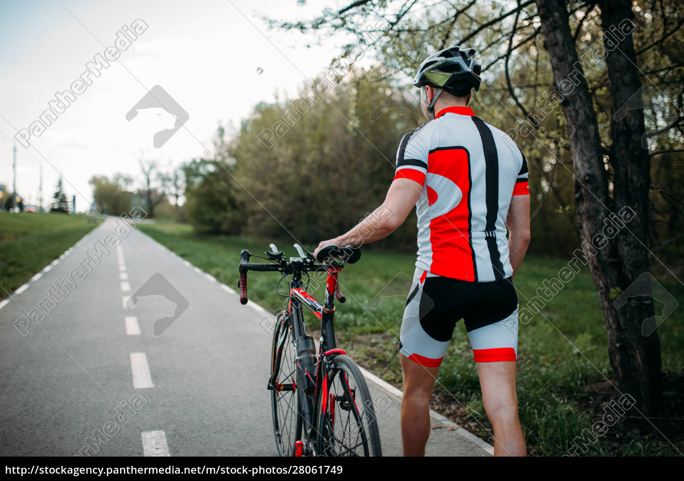 cyclist, in, helmet, and, sportswear, rides - 28061749