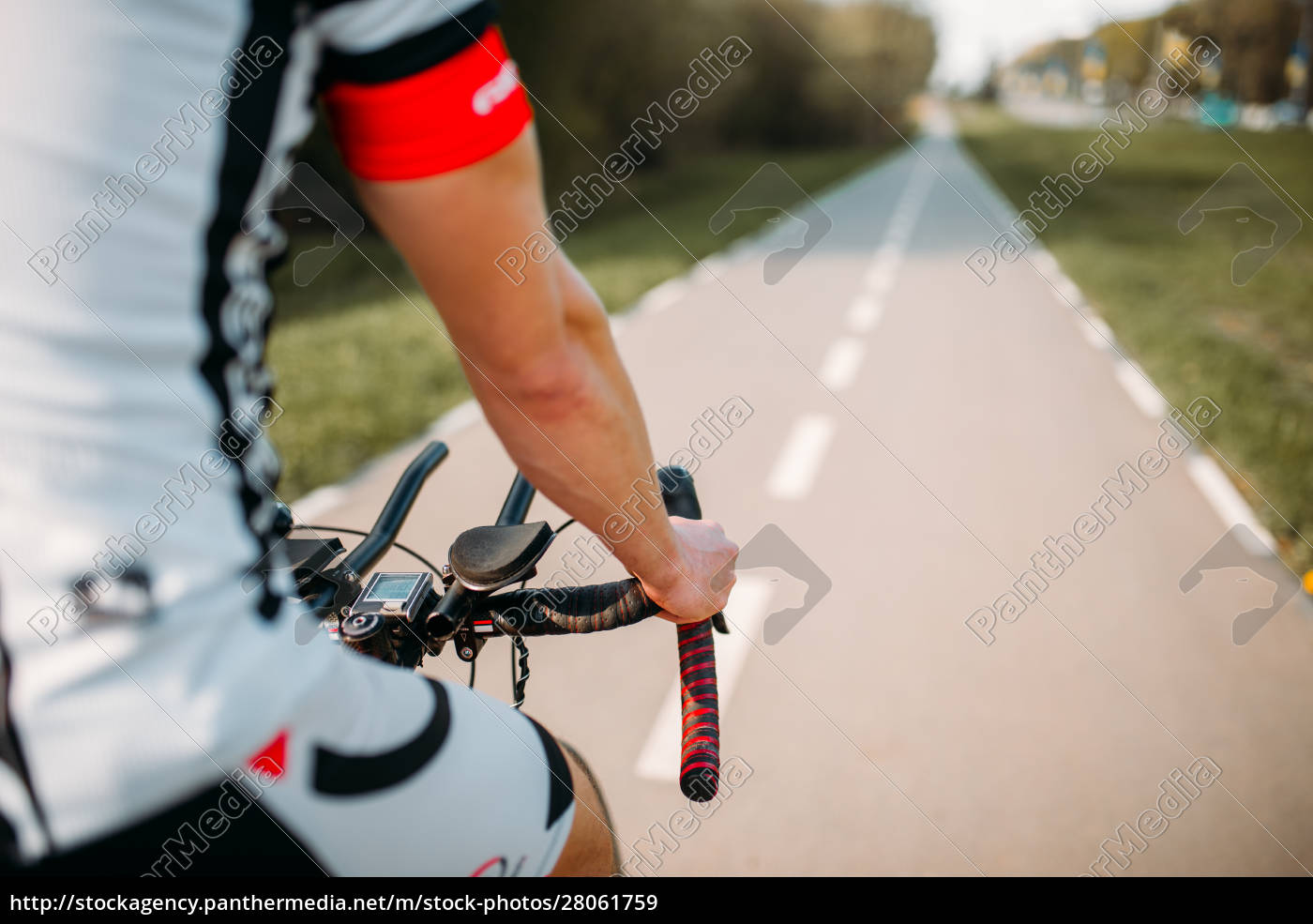 cyclist, in, helmet, and, sportswear, rides - 28061759