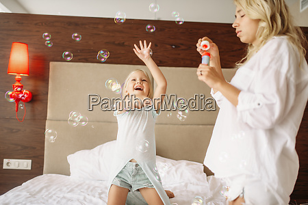 funny, mother, and, child, blowing, bubbles - 28061780
