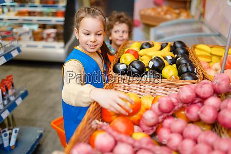 girl, in, uniform, playing, saleswoman, , playroom - 28061684