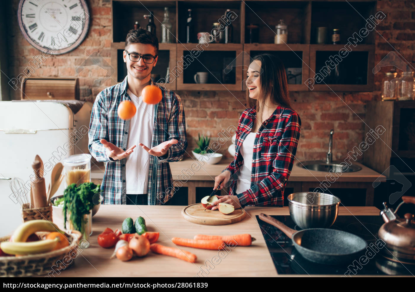 husband, juggles, oranges, while, wife, cooking - 28061839