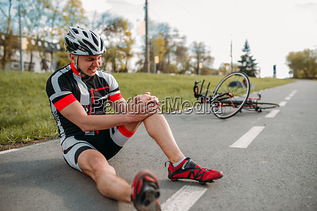 male, bycyclist, fell, off, bike, and - 28061438