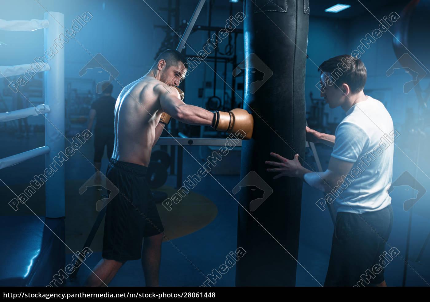 man, in, black, handwraps, exercises, with - 28061448