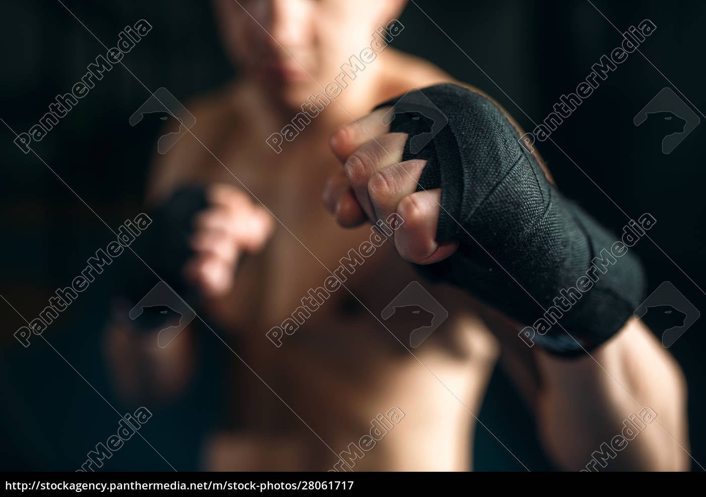 muscular, male, person, in, black, bandages - 28061717