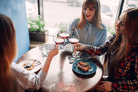three, girlfriends, holding, beverages, in, glasses - 28061560