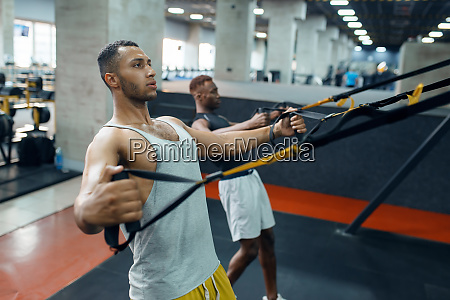 two, athletes, at, exercise, machine, , training - 28061795
