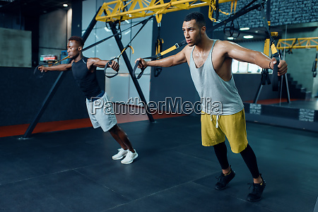 two, athletes, at, stretching, exercise, machine - 28061787