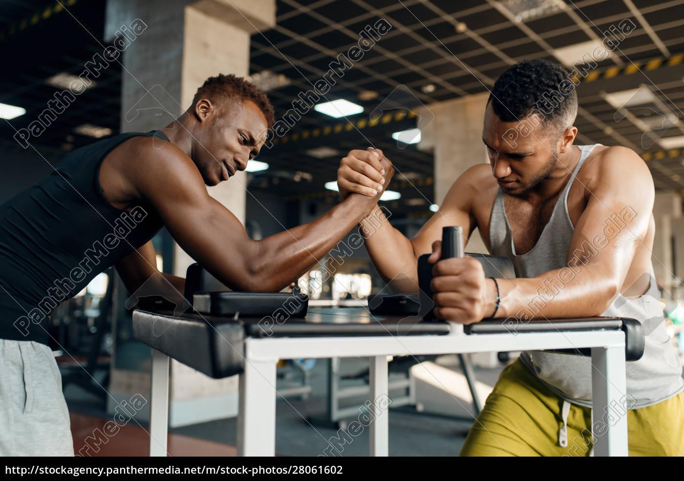 two, men, fighting, , arm, wrestling, training - 28061602