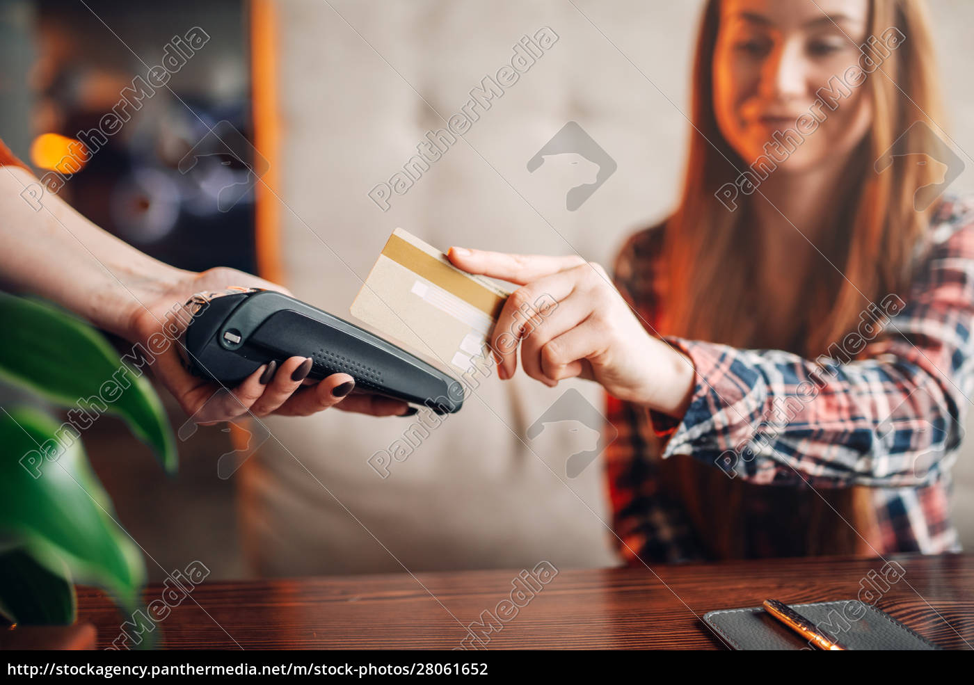 young, woman, pay, by, mobile, phone - 28061652